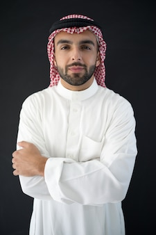 Portrait of attractive arab man on black