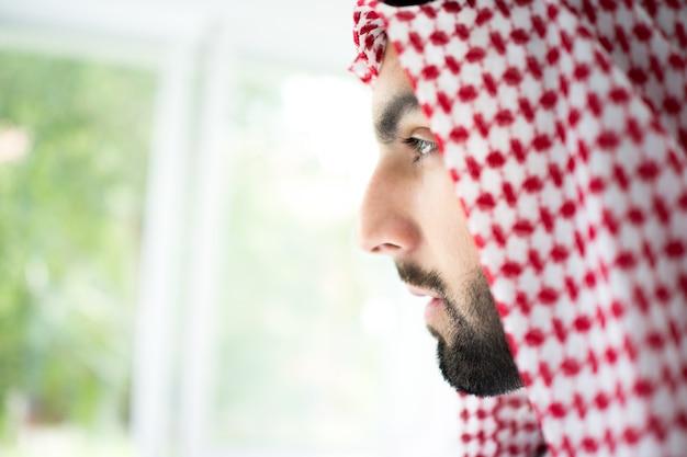 Portrait of attractive arab man with sheikh robe