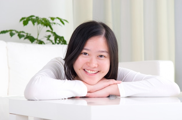 Portrait of attractive asian girl smiling. young woman indoors living lifestyle at home.