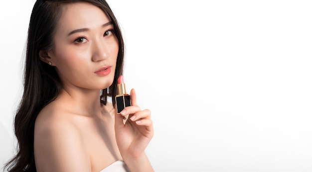 Portrait of attractive beauty asian woman in fashion posing with lipstick