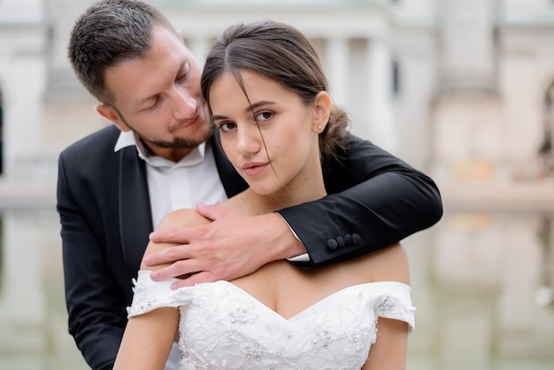 Portrait of attractive brunette bride and handsome groom
