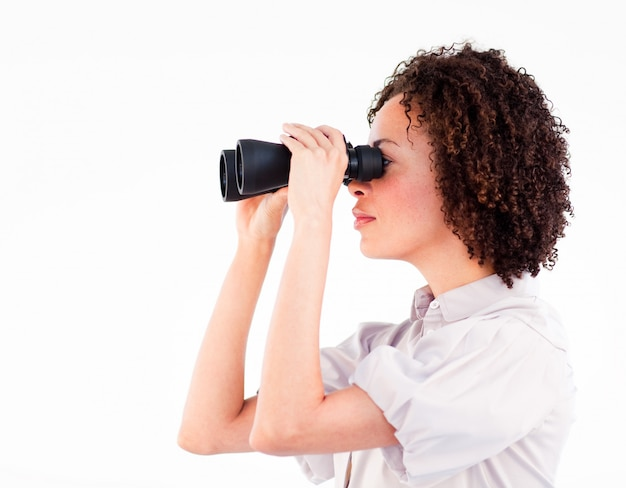 Portrait of attractive businesswoman using binoculars