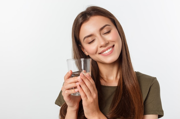 Portrait of attractive caucasian smiling woman drinking water.