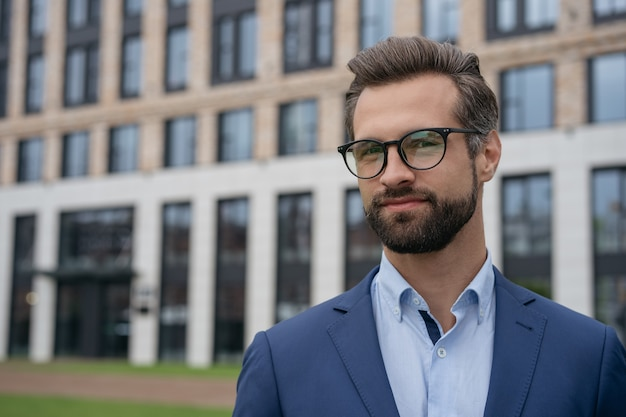 Portrait of attractive pensive banker looking at camera copy space successful business