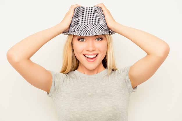 Portrait of attractive smiling blonde wearing summer hat