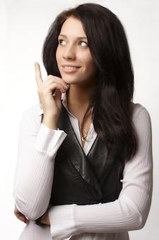 Portrait of attractive thinking brunette businesswoman