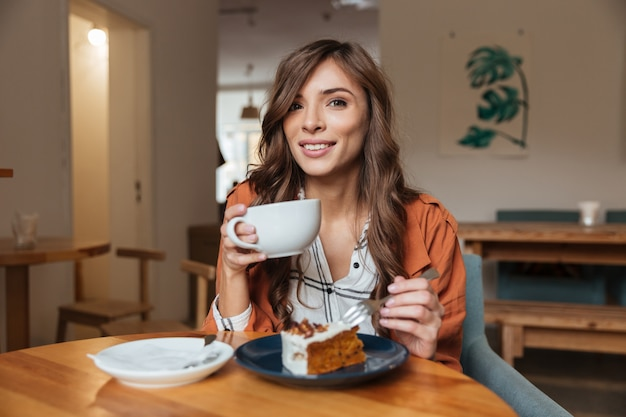 Portrait of an attractive woman eating