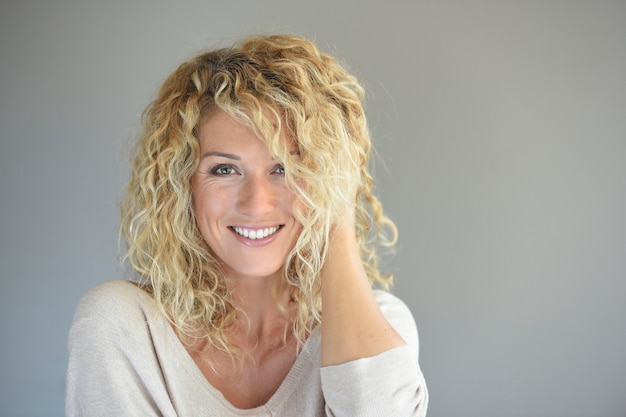Portrait of attractive woman with long curly hair