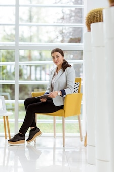 Portrait of attractive young business woman working online with a digital tablet