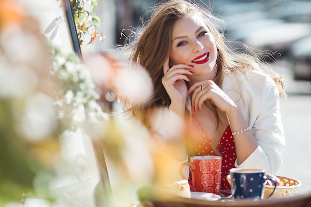 Portrait of attractive young girl outdoors. beautiful urban lady smiling at camera.