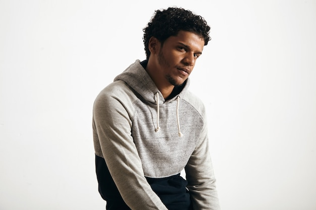 Portrait of attractive young man wearing blank normcore clothes grey seat hoodie seriously