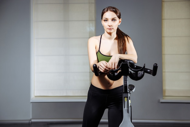 Portrait of attractive young woman in the gym.