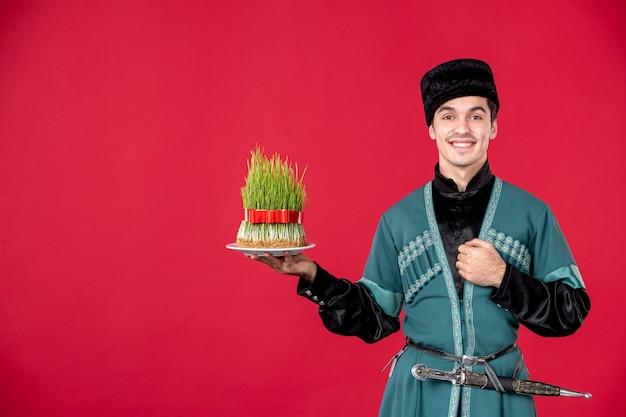 Portrait of azeri man in traditional costume holding semeni smiling studio shot red performer dancer novruz spring