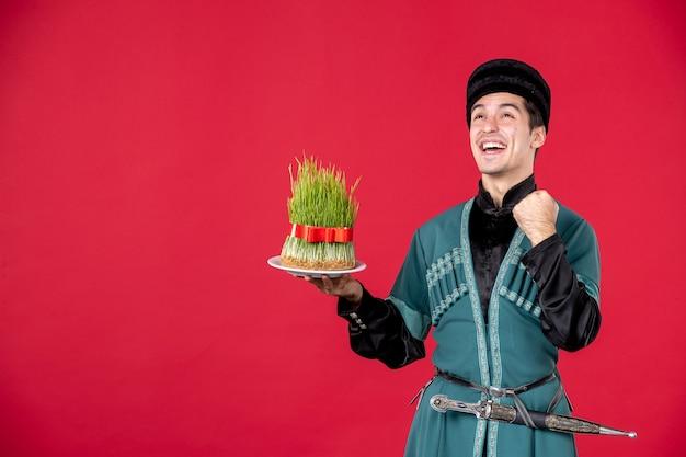 Portrait of azeri man in traditional costume holding semeni studio shot red dancer spring performer