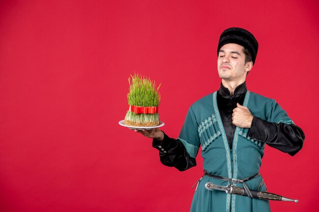 Portrait of azeri man in traditional costume holding semeni studio shot red novruz dancer performer