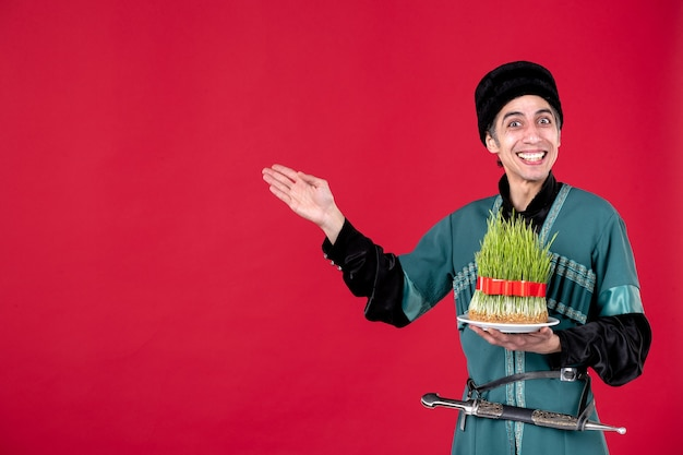 Portrait of azeri man in traditional costume with semeni on red dancer holiday ethnic novruz spring