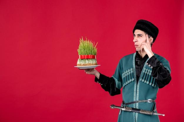 Portrait of azeri man in traditional costume with semeni on red novruz spring dancer ethnic