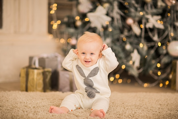 Portrait of a baby boy on a christmas background