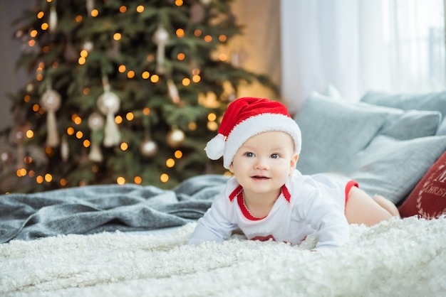 Portrait of a baby boy in santa hat