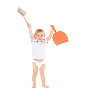 Portrait of baby boy with with dustpan and brush