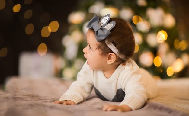 Portrait of a baby girl on a christmas background