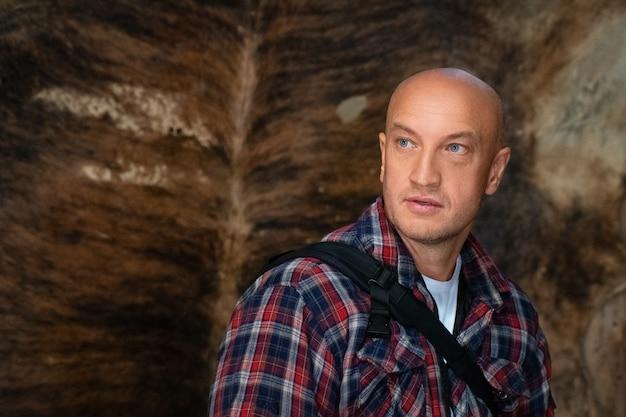 Portrait of a bald man in a checkered shirt