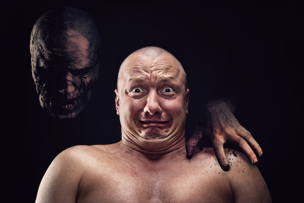 Portrait of bald scared man