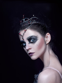Portrait of ballerina as swan on black