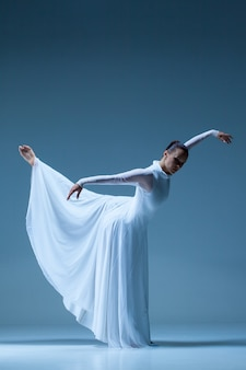 Portrait of the ballerina on blue wall