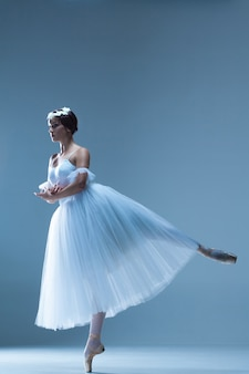 Portrait of the ballerina on blue