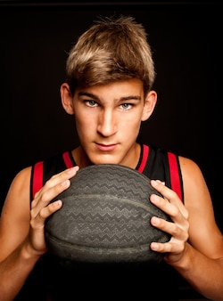 Portrait of basketball player on gray