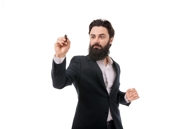 Portrait of a bearded businessman writing, drawing on the screen, isolated on white background
