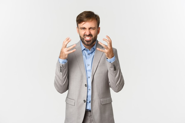 Portrait of bearded male employee, complaining and shaking hands