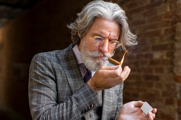 Portrait of bearded male lightning cigar