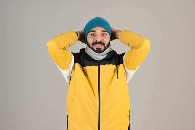 Portrait of bearded man in warm clothes standing and posing .