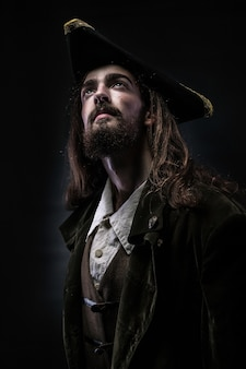 Portrait of a bearded pirate thoughtfully looking up
