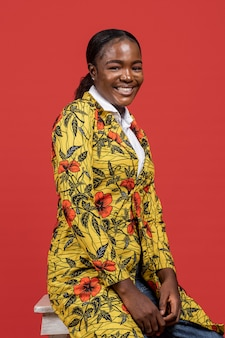 Portrait of beautiful african woman in floral coat