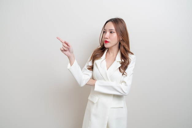 Portrait beautiful asian business woman with hand presenting or pointing on white background