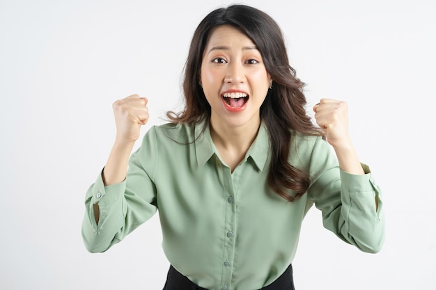 Portrait of a beautiful asian businesswoman showing feelings of victory
