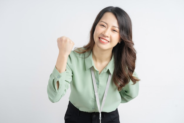Portrait of a beautiful asian businesswoman showing a successful expression