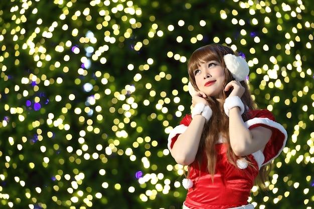 Portrait of beautiful asian female santa in christmas