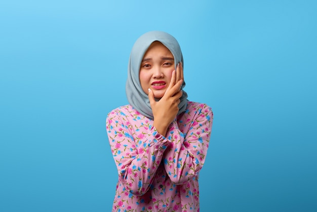 Portrait of beautiful asian woman having toothache with pain expression