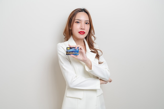Portrait beautiful asian woman holding credit card on white background