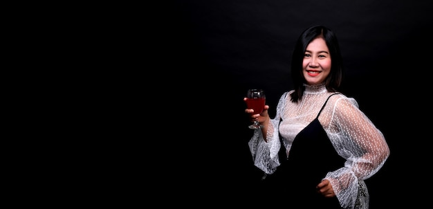 Portrait of beautiful asian woman holding a glass of champagne