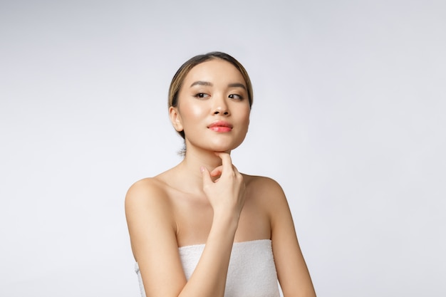 Portrait of beautiful asian woman makeup of cosmetic, girl hand touch cheek
