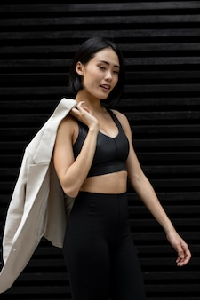Portrait of beautiful asian woman posing in athleisure outdoors