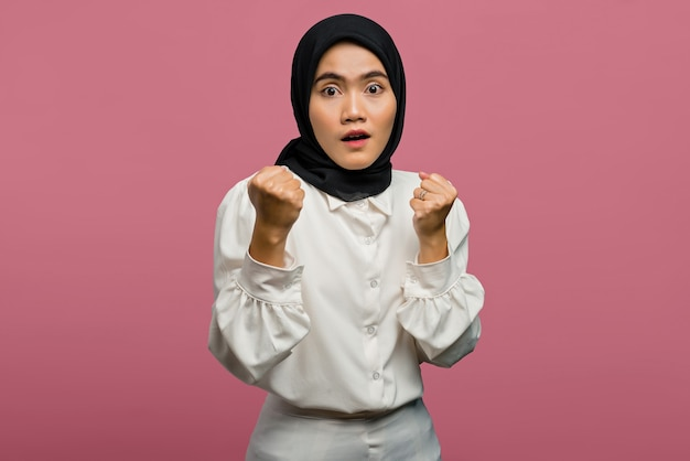 Portrait of beautiful asian woman shocked and excited wearing a white shirt