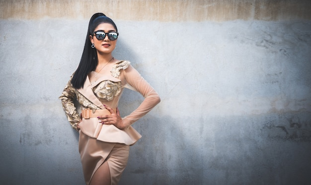 Portrait of beautiful asian woman standing beside swimming pool outdoor
