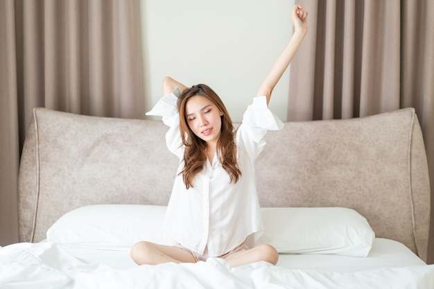 Portrait beautiful asian woman wake up on bed in the morning