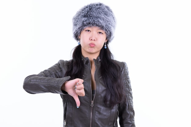 Portrait of beautiful asian woman wearing fur hat ready for winter isolated on white
